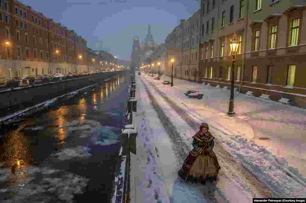 On one of St. Petersburg's changeless avenues, Petrosyan captured this image of a woman dressed in period costume.