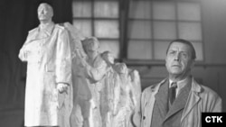 Sculptor Otakar Svec stands with the model of his giant Stalin memorial in 1953.