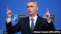 NATO Secretary-General Jens Stoltenberg talks to reporters ahead of a defense ministers meeting at NATO headquarters in Brussels on February 12.