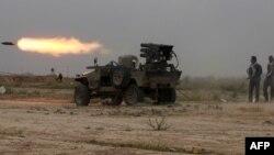 Իրաք - Շիա աշխարհազորայինները հրթիռներ են արձակում Թիքրիթի կենտրոնում մնացած «Իսլամական պետության» զինյալների ուղղությամբ, 12-ը մարտի, 2015թ․