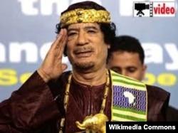 Муаммар Каддафи (1940 же 1942 -- 2011).