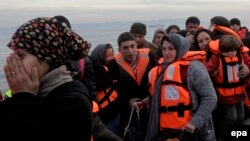 Refugees and migrants arrive by dinghy from Turkey on the Greek island of Lesbos in February. Despite Ankara's crackdown on such transports, people smugglers are confident that it won't have too much of an adverse impact on their trade.