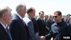 Russian President Dmitry Medvedev (right) is welcomed to Makhachkala.
