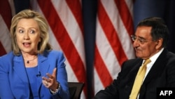 U.S. Secretary of State Hillary Clinton and Defense Secretary Leon Panetta during a conversation hosted by the National Defense University and CNN in Washington on August 16