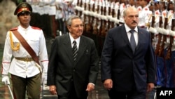 Belarus President Alyaksander Lukashenka (right) is received by Cuban President Raul Castro at the Revolution Palace in Havana on June 25.
