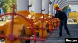 A worker turns a valve at an underground gas storage facility near Stryi, Ukraine.