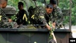 По сообщениям из Таиланда, обыватели спокойно отнеслись к возвращению военных во власть