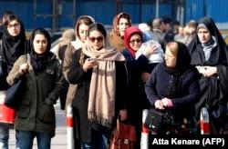 Iranian women wearing the compulsory hijab walk down a street in the capital, Tehran. (file photo)
