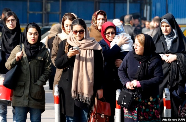 Iranian women wearing the compulsory hijab walk down a street in the capital, Tehran. (file photo)