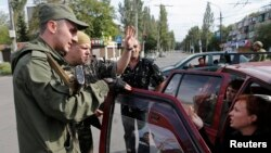With so many armed men patrolling the streets, it's easy to end up in a separatist jail in Donetsk. (file photo)