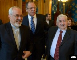 Russian Foreign Minister Sergei Lavrov (center) is hosting Iranian Foreign Minister Mohammad Javad Zarif (left) and Syrian Foreign Minister Walid al-Muallem in Moscow. (file photo)