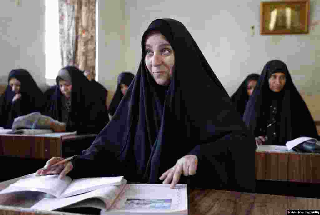 Iraqi women take part in a governmental literacy program for adults in the holy city of Najaf. (AFP/Haidar Hamdani)