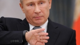 President Vladimir Putin says nationalists are taking  advantage of democratic freedoms.