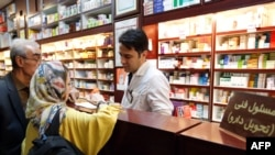 "Iranians shop at a drugstore at the Nikan hospital in Tehran on September 11, 2018. - Judges at the International Court of Justice in The Hague unanimously ruled Washington should remove barriers to ""the free exportation to Iran of medicines and medical d"