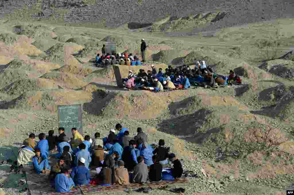 Afghan schoolchildren study at an open-air classroom in the Mohmand Dara district in eastern Nangarhar Province. (AFP/Noorullah Shirzada)