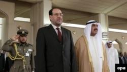 نوری المالکی همراه با نخست وزیر کویت در جریان سفرش به کویت.(عکس از epa)