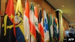 Algeria -- An Algerian security guard stands near the flags of member states of the Organization of the Petroleum Exporting Countries (OPEC) at the Sheraton hotel, Oran, 14Dec2008