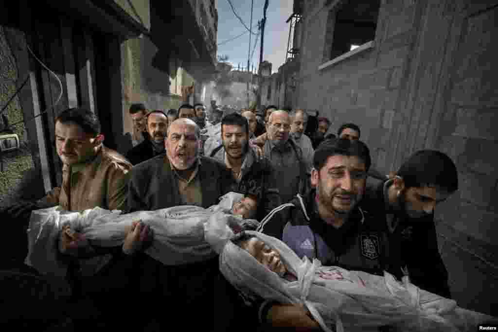 "Paul Hansen of Sweden, a photographer working for the Swedish daily ""Dagens Nyheter,"" won the World Press Photo of the Year 2012 with this picture of a group of men carrying the bodies of two dead children through a street in Gaza City. ""The strength of the picture lies in the way it contrasts the anger and sorrow of the adults with the innocence of the children. It's a picture I will not forget,"" jury member Mayu Mohanna said."