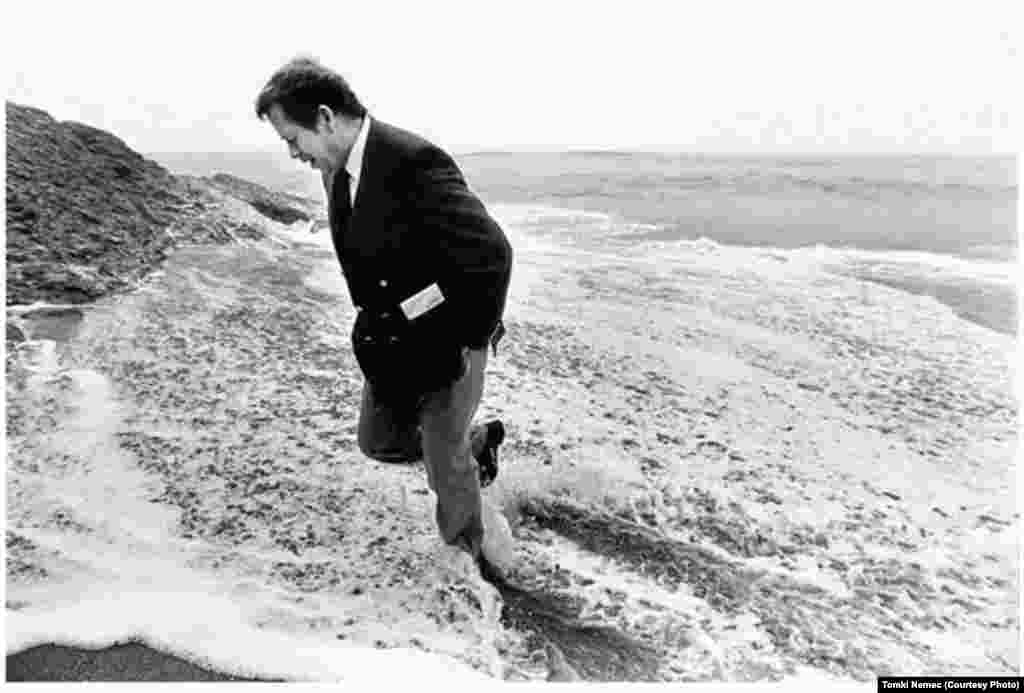 Havel wades in the Atlantic Ocean in Cabo da Roca, Portugal, near the westernmost tip of the European continent, on December 14, 1990.