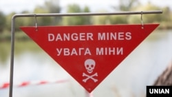 A sign warning of the danger of landmines in eastern Ukraine (file photo).