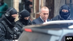 Former Kosovo Prime Minister Ramush Haradinaj leaves the prison of Colmar surrounded by police officers on January 12.