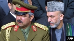 Afghan President Hamid Karzai (right) and General Abdul Rashid Dostum in March 2002.