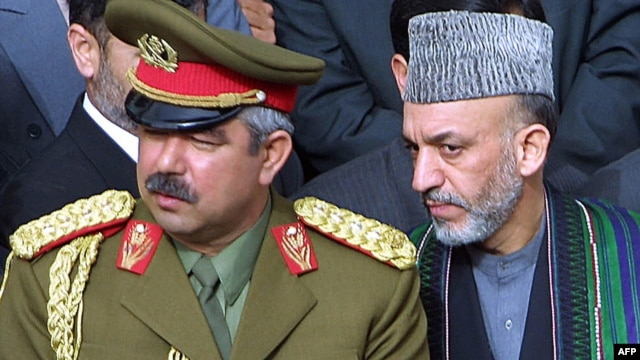 Hamid Karzai (right) with then Deputy Defense Minister General Abdul Rashid Dostum in March 2002.