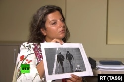 RT editor in chief Margarita Simonyan during her interview with Barishov and Petrov
