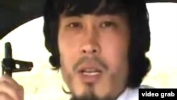 Скриншот видеозаписи, герой которой призывает к джихаду.