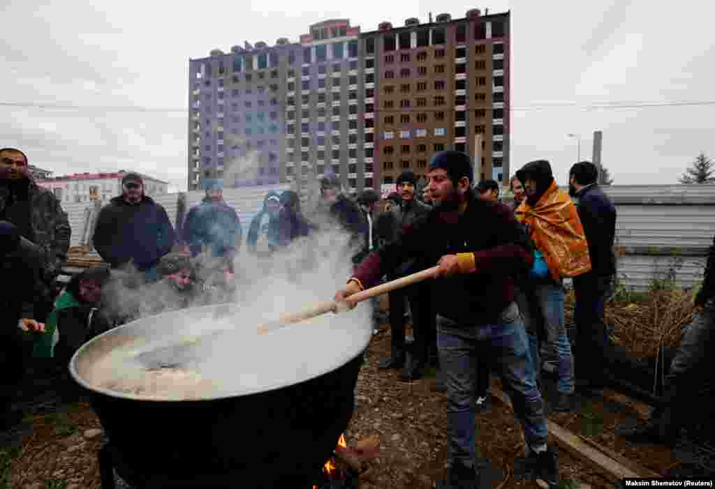 A man in Ingushetia's capital, Magas, prepares a meal during a protest against what participants say was an unfair land swap deal with the neighboring Russian region of Chechnya. (Reuters/Maxim Shemetov)