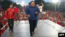 Chavez takes the stage in his blue tracksuit during a campaign rally in Barquisimeto on October 2.