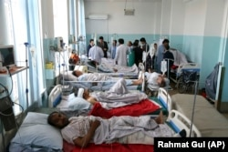 Wounded people receive treatment in a hospital after the blast in Kabul on July 1.