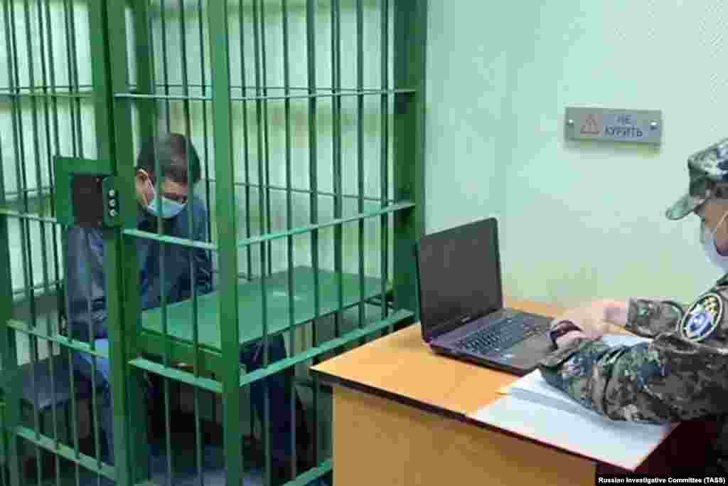 An investigator interrogates Vyacheslav Starostin, who was in charge of the power plant where the incident occurred. On June 4, a regional court ordered that Starostin be placed in pretrial detention until July 31. He was charged with negligence and violating environmental regulations.