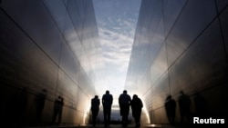 People walk through the 9/11 Empty Sky memorial across from New York's One World Trade Center at Liberty State Park in Jersey City, New Jersey, on September 9.