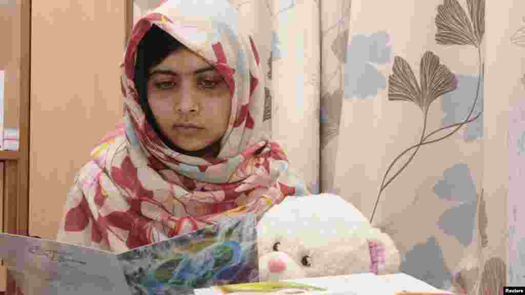 Pakistani schoolgirl Malala Yousafzai reads a get-well card as she recuperates at the the Queen Elizabeth Hospital in Birmingham, England. Malala, who was shot in the head by the Taliban for advocating girls' education, was flown from Pakistan to Britain for specialist treatment after the October 9 attack. (Reuters)
