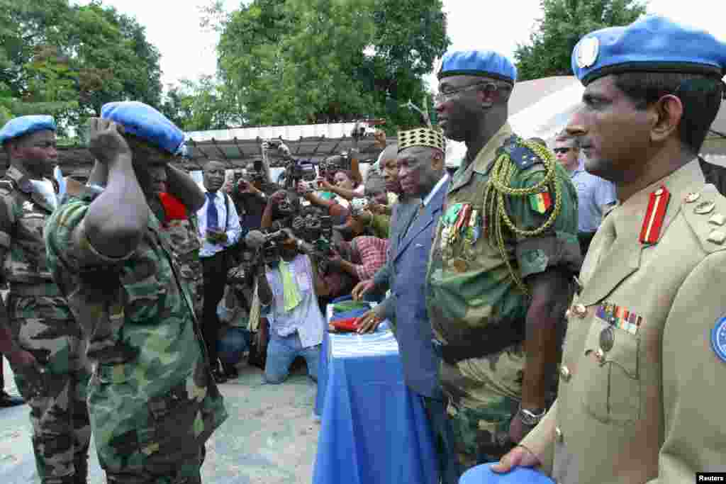 UN forces take part in an official ceremony to mark the launch of a UN peacekeeping mission in Ivory Coast in 2004.