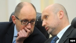 Former Prime Minister Arseniy Yatsenyuk (left) and National Security and Defense Council chief Oleksandr Turchynov are both on the list.