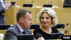 Denis Voronenkov (left) and his wife, Maria Maksakova, who is also a former Russian lawmaker, left Russia for Ukraine in October 2016. (file photo)