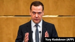 "Russian Prime Minister Dmitry Medvedev delivers a speech in the State Duma in Moscow on April 11: ""We will not forget."""
