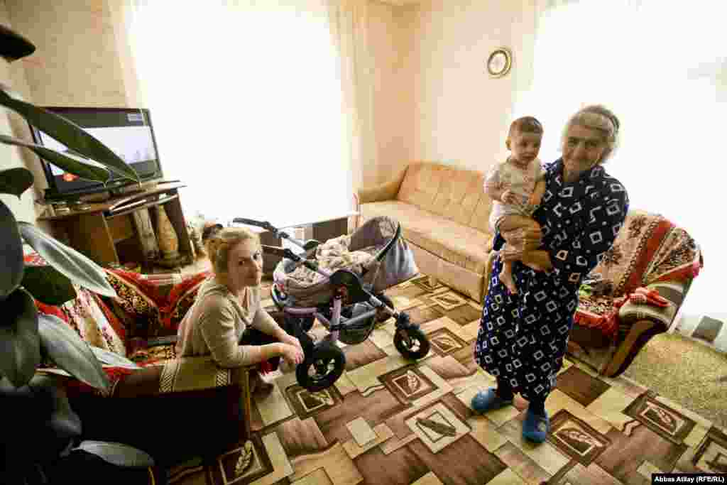 Nine people from four generations live in the Kalayzhan house. The youngest in the house is ten-month-old Karina.