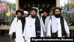 FILE: Members of a Taliban delegation, led by chief negotiator Mullah Abdul Ghani Baradar (center, front), leave after peace talks with Afghan senior politicians in Moscow in May 2019.