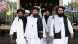 Members of a Taliban delegation, led by chief negotiator Mullah Abdul Ghani Baradar (center), leave after peace talks with Afghan politicians in Moscow in May.