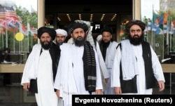 Members of a Taliban delegation leave after peace talks with Afghan senior politicians in Moscow in May.