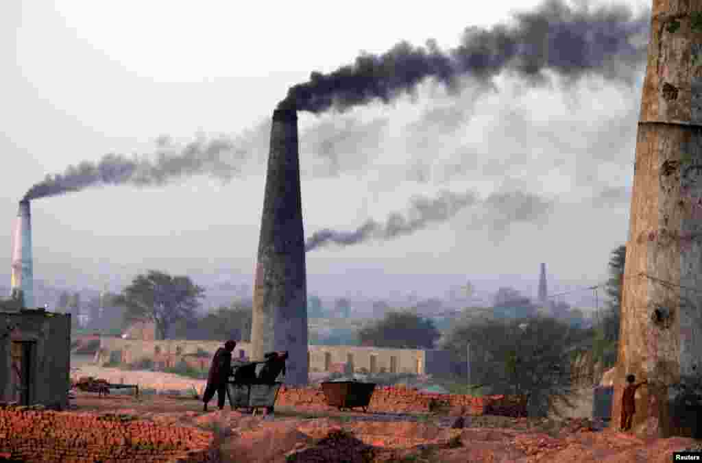 Smoke rises from brick factories on the outskirts of Islamabad on June 8. (Reuters/Faisal Mahmood)