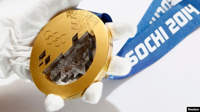 A gold medal manufactured for the 2014 Winter Olympic Games in Sochi is seen on display at a Moscow jewelery factory on June 28.