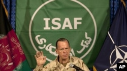 Admiral Mike Mullen, chairman of the U.S. Joint Chiefs of Staff, addresses a press conference in Kabul on July 31.