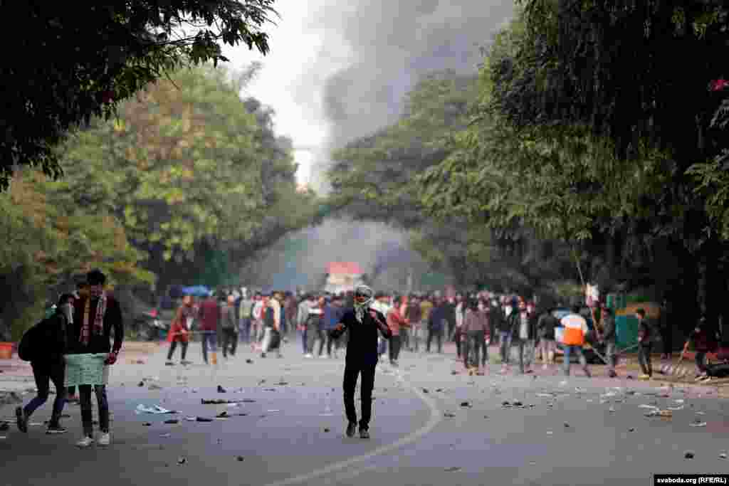 Demonstrators hurl stones towards police during a protest in New Delhi on December 15.