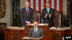 Afghan President Ashraf Ghani (center) is applauded by House Speaker John Boehner (right) and Vice President Joe Biden (left) as he arrives to addresses a joint session of Congress at the U.S. Capitol in Washington in 2015.