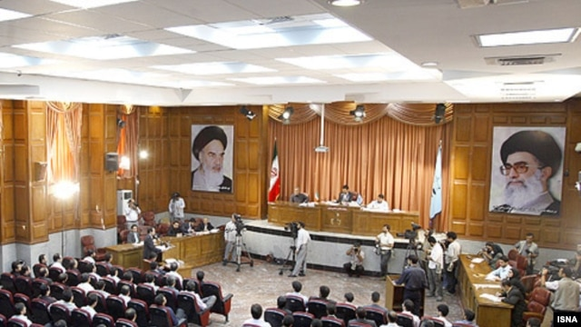 Suspected opposition supporters on trial in Tehran.