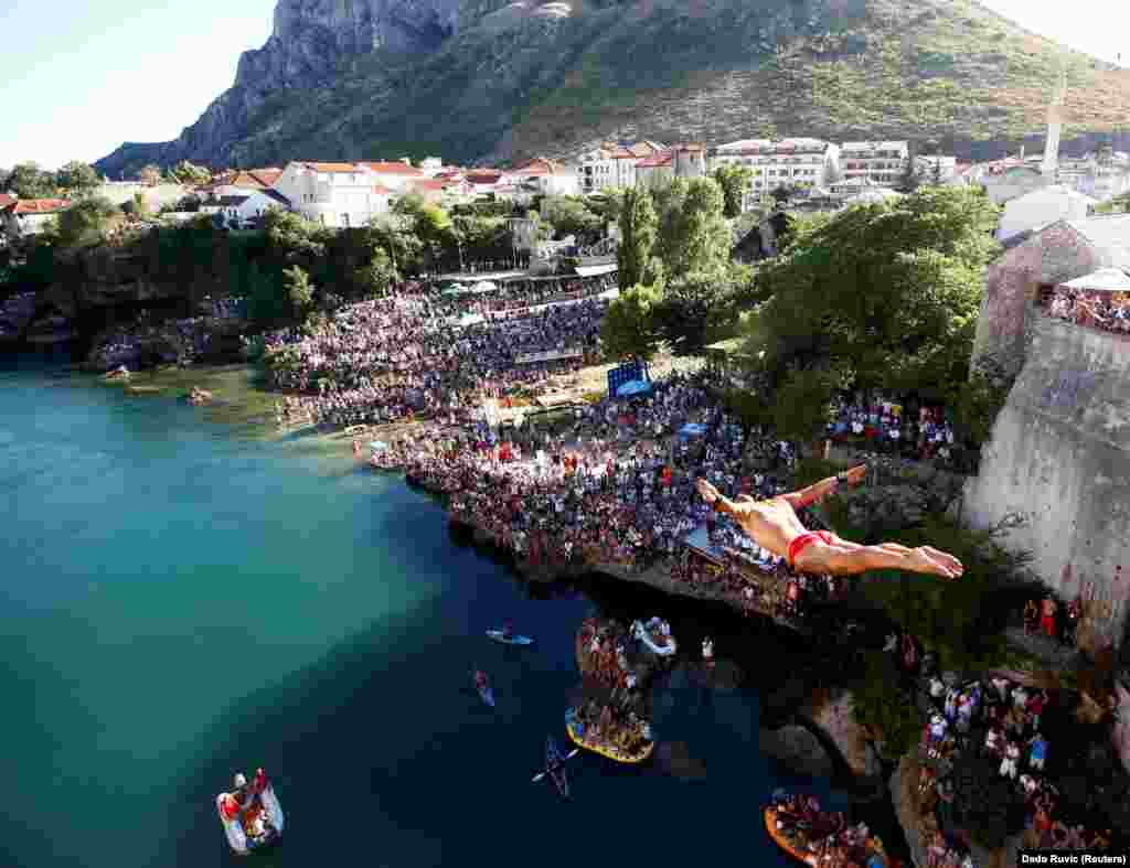 Lorens Listo jumps from the Old Bridge during the 451st diving competition in Mostar, Bosnia- Herzegovina. (Reuters/Dado Ruvic)